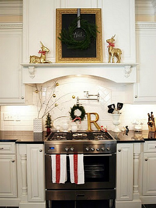A kitchen with a stove top oven decorated for Christmas
