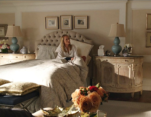 Lydia sitting in bed in the guest room