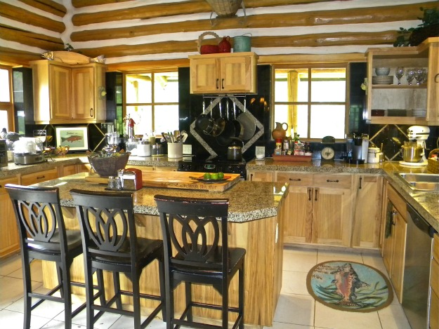 A kitchen in a log home