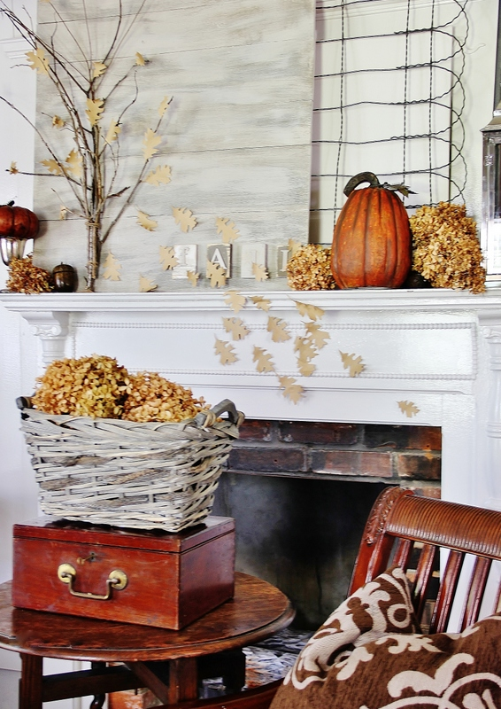 Mantel decorated for fall with pumpkins