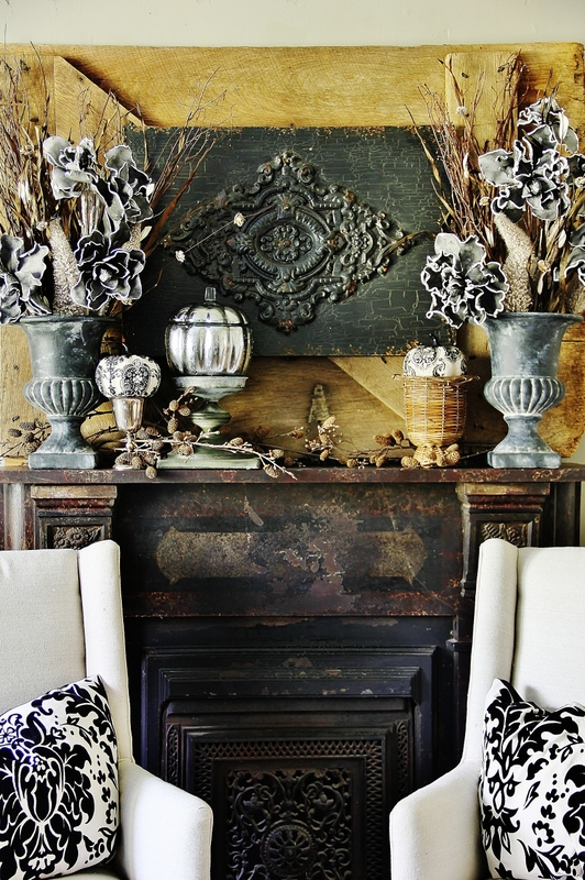 antique fireplace decorated for fall