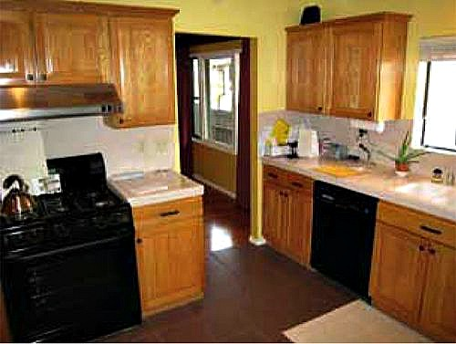 Before after a modern take on a 100 year old craftsman hooked on houses - Modern kitchen with black appliances ...