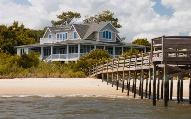 A close up of a pier next to water outside Emily\'s beach house on Revenge