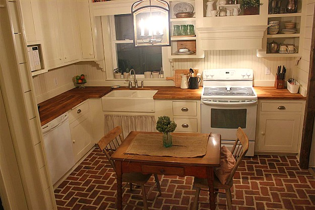 A kitchen with small table and chairs