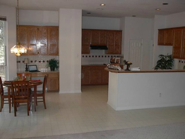 A kitchen with a dining room table before remodel