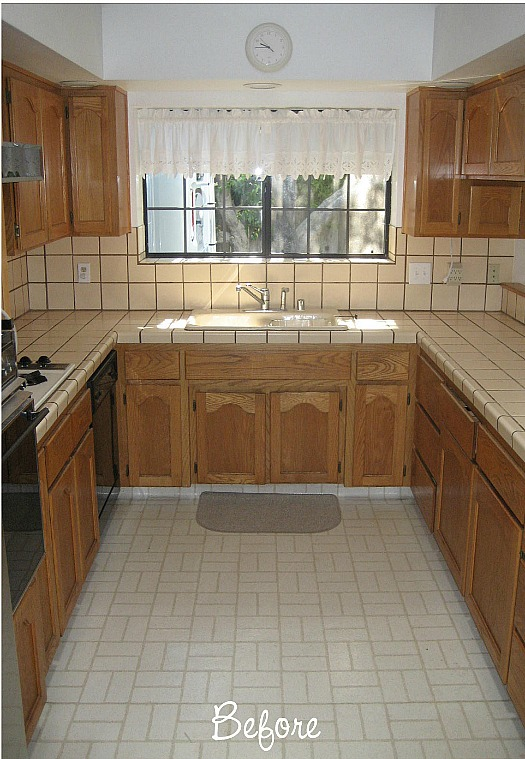 A kitchen with a tile floor before remodel