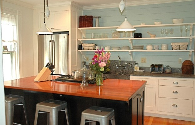 A kitchen with open shelves
