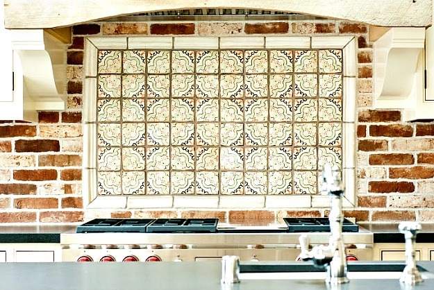 closeup of painted tile behind range