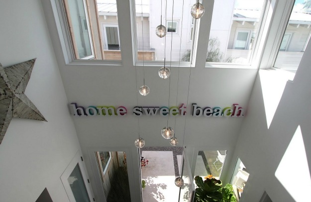sign on wall that says home sweet beach