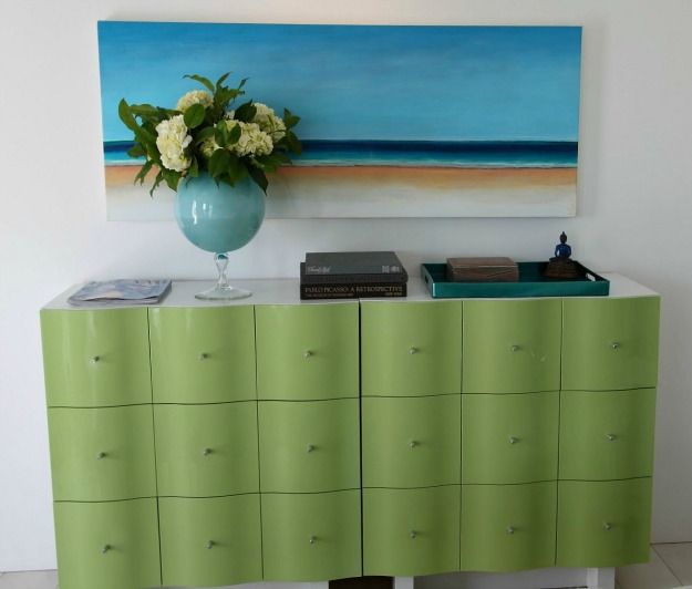 A close up of a green dresser