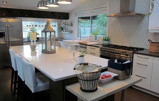 A kitchen with black cabinets and large island