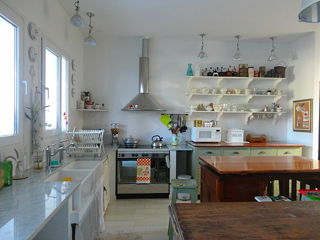 Silvina\'s kitchen in Argentina with stainless vent hood