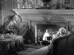 Bing Crosby and Marjorie Reynolds by the fire