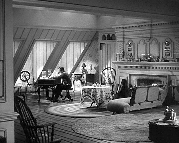 black and white photo of Bing Crosby sitting at piano