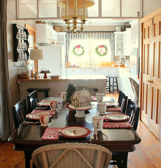 A kitchen with a dining table set for the holidays