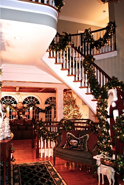 staircase decorated with garland for Christmas