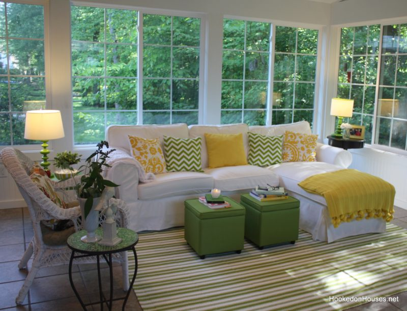 My sunroom decorated with green and yellow and Ektorp sofa