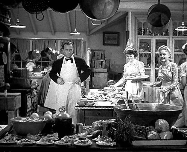 Bing Crosby and workers in kitchen