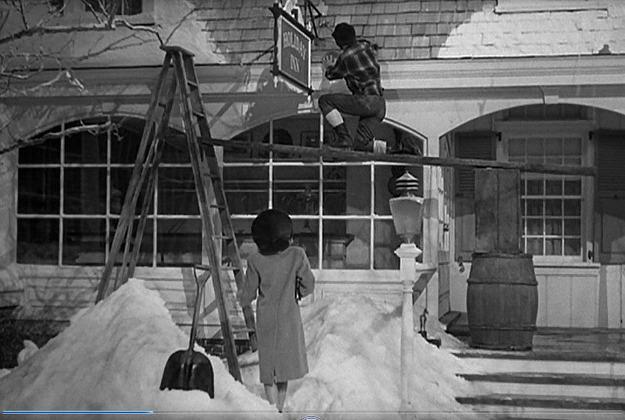 screenshot of Bing Crosby hanging sign on Holiday Inn in movie