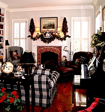 A living room decorated for Christmas with fireplace