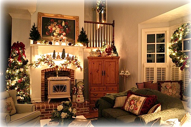 A christmas tree in a living room filled with furniture and a fire place