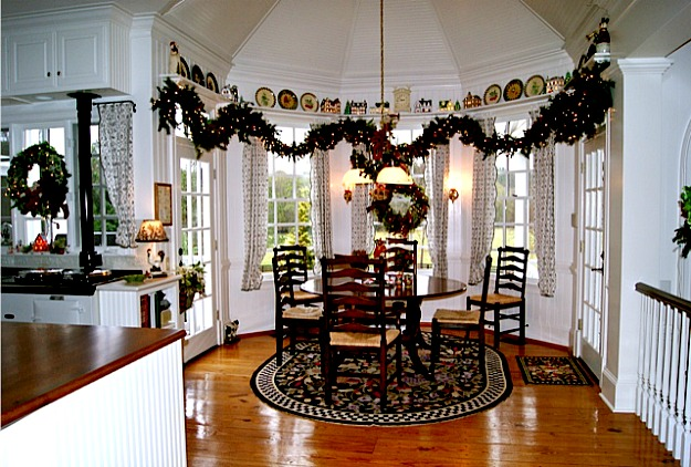 eating area of kitchen with garland over windows