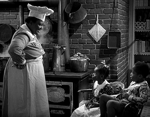 Mamie and her kids in Holiday Inn kitchen