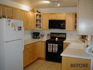 A kitchen with a stove sink and refrigerator before remodel