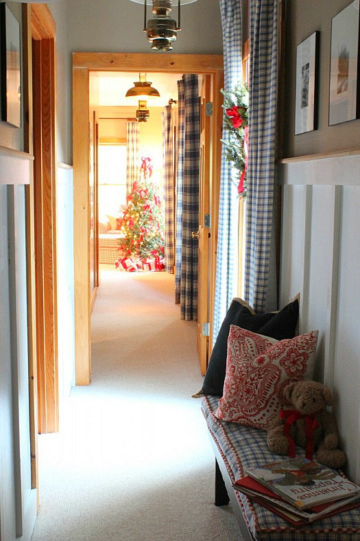 hallway leading to bedroom with Christmas tree