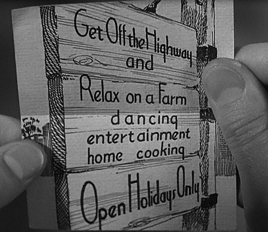 closeup of invitation that advertises Holiday Inn in movie