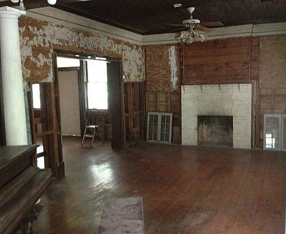 A living room with fireplace before remodel