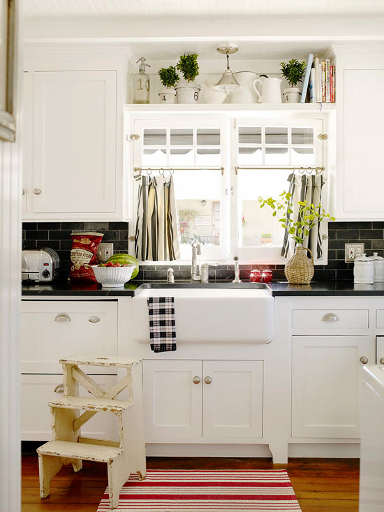 A beach cottage that 39 s black and white and red all over - White kitchen red accents ...