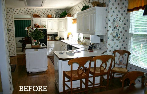 A kitchen before remodel with wallpaper