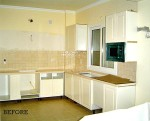 A kitchen with a sink and a microwave before remodel