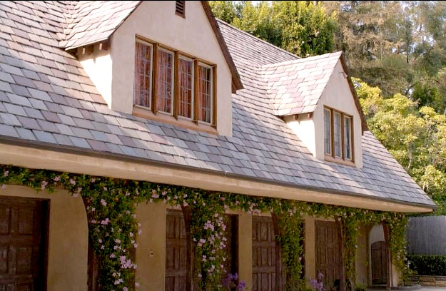 A close up of carriage house and garage doors