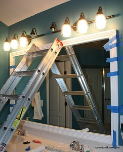 framing the bathroom plate glass mirror