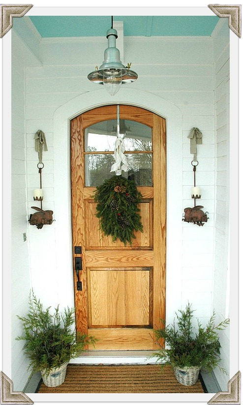 front door decorated for winter corners