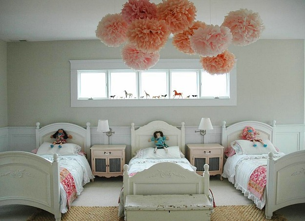 girls bedroom with pink pom poms