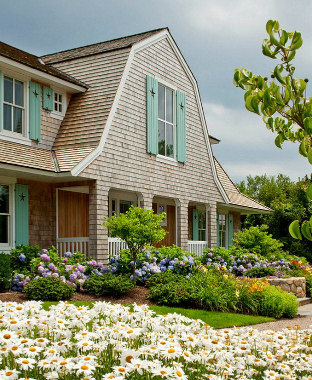 A Shingled House With Aqua Shutters On Cape Cod