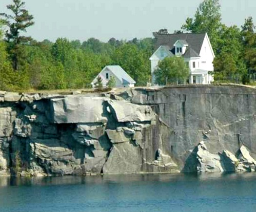 white Victorian overlooking quarry with lake