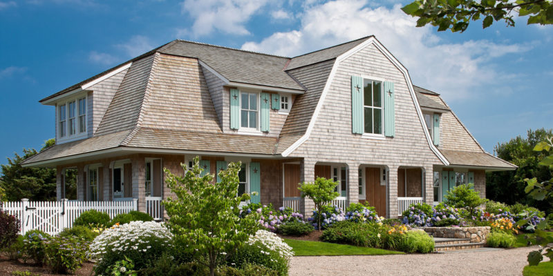 front exterior of Little Beach Shingle style house with aqua blue shutters
