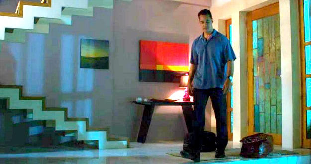 A man standing in a room of Rebecca\'s house