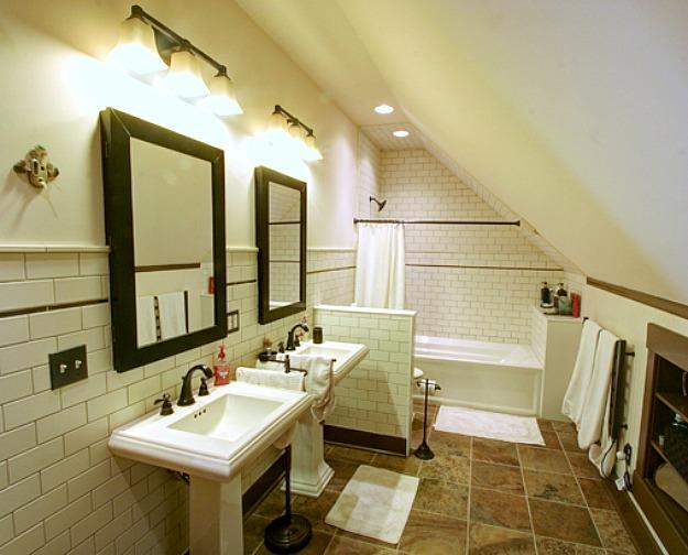 bathroom with slanted attic wall