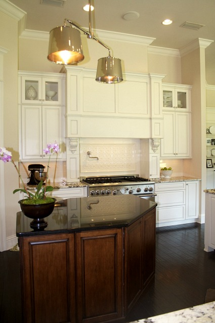 Lori 39 s cream peacock of a kitchen in florida hooked on houses - White kitchen with dark island ...