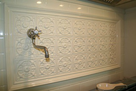 backsplash tile over range pot filler