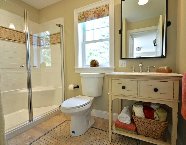 bathroom after remodel Before & After: Turning a Small Ranch Into a 2 Story House