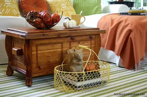 closeup of yellow metal basket with wood squirrel figure