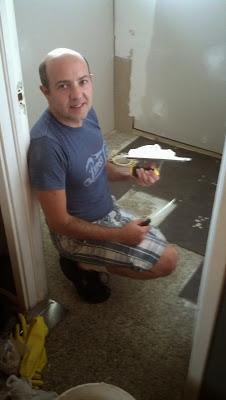 Renato installing new bathroom flooring