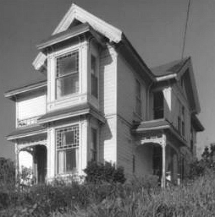 Charmed Halliwell Manor old bw photo of house