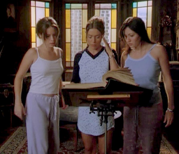Charmed sisters in attic with Book of Shadows